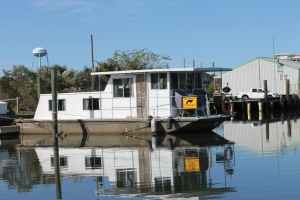 House boat with Manatee sign.